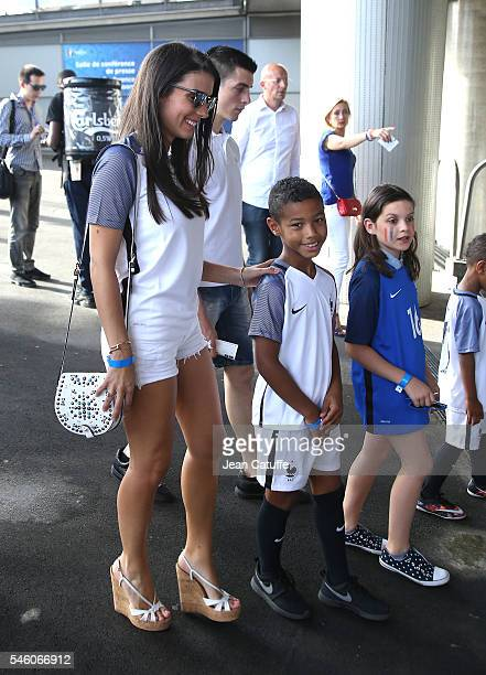 Ludivine Sagna and her son attends the UEFA Euro 2016 final match between Portugal and France at Stade de France on July 10 2016 in SaintDenis near...