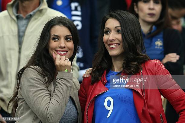 Ludivine Sagna wife of Bacary Sagna looks on next to Jennifer Giroud wife of Oliveir Giroud during the UEFA Euro 2016 Quarter Final match between...