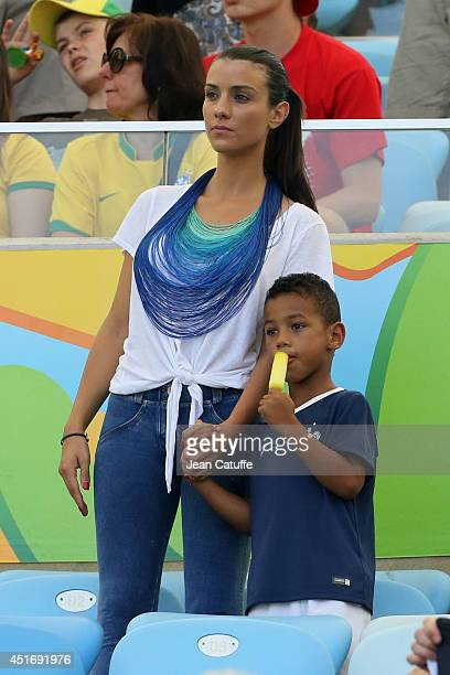 Ludivine Sagna wife of Bacary Sagna of France attends with her son the 2014 FIFA World Cup Brazil Quarter Final match between France and Germany at...