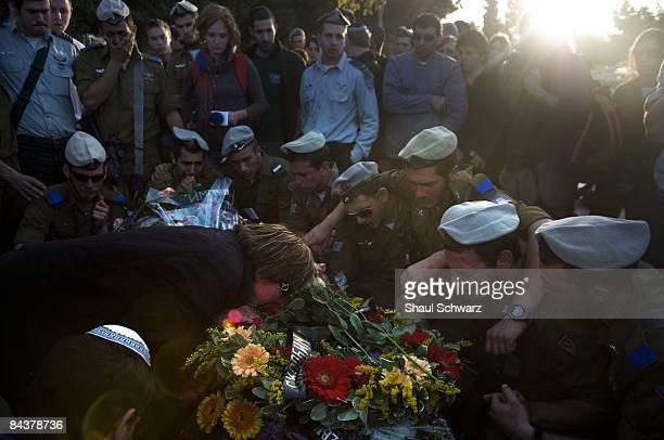 Ludmila Mashavisky hugs the casket of her son Staff Sgt Alex Mashavisky goodbye as fellow Israeli soldiers mourn during his funeral on January 7 2009...