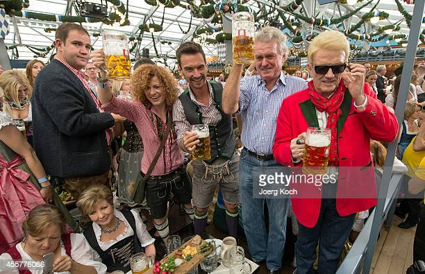 Ludmilla 'Lucy' Diakovska Florian Silbereisen Sepp Meier and singer Heino pose with beer mugs after Munichs major has taped the first Oktoberfest...