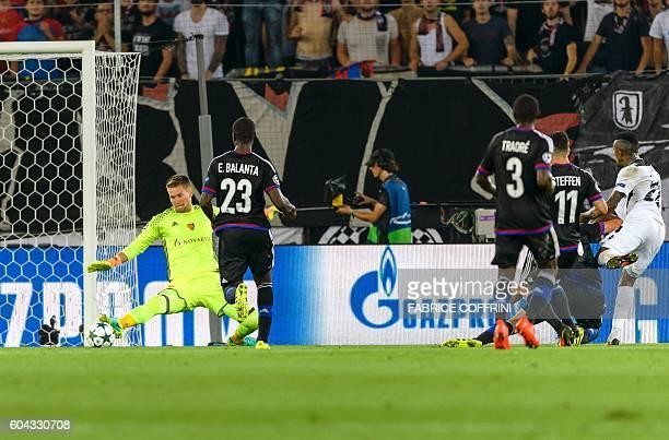 Ludogorets' Brazilian forward Jonathan Cafu scores a goal against Basel's Czech goalkeeper Tomas Vaclik during the UEFA Champions League group A...