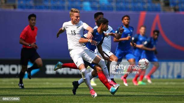 Ludovic Blas of France is tackled by James McGarry and Moses Dyer of New Zealand during the FIFA U20 World Cup Korea Republic 2017 group E match...