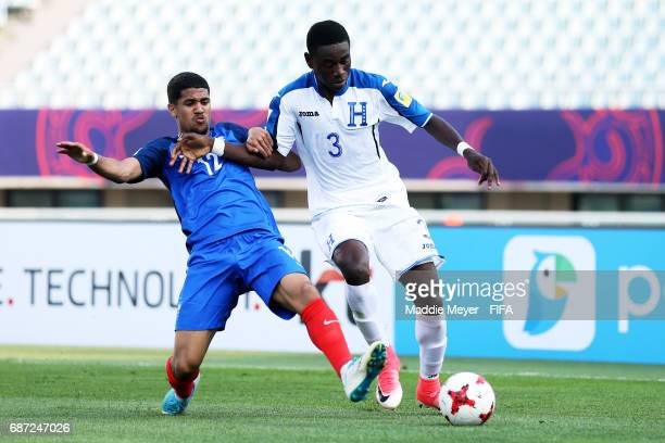 Ludovic Blas of France slide tackles Wesly Decas of Honduras during the FIFA U20 World Cup Korea Republic 2017 group E match between France and...