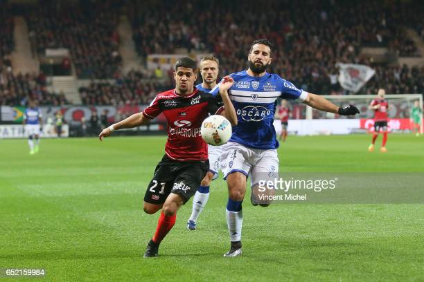 Ludovic Blas of Guingamp and Abdelhamid El Kaoutari of Bastia during the Ligue 1 match between EA Guingamp and SC Bastia at Stade du Roudourou on...