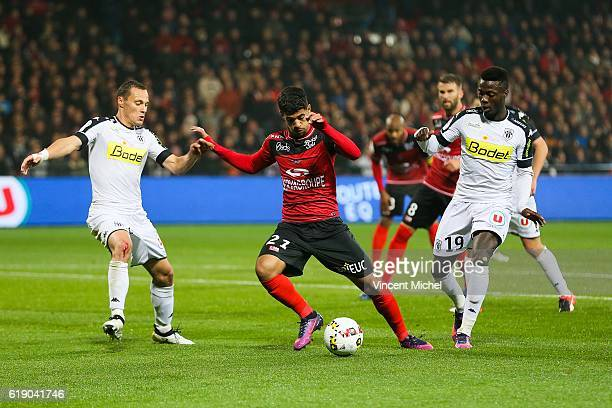 Ludovic Blas of Guingamp and Vincent Manceau and Nicolas Pepe of Angers during the Ligue 1 match between Guingamp and Angers at Stade du Roudourou on...