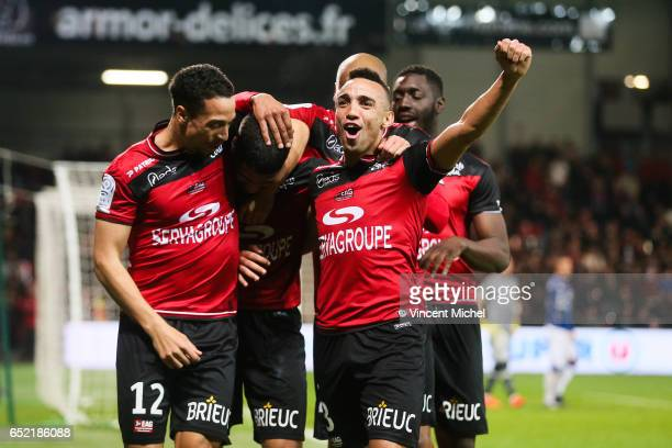 Ludovic Blas of Guingamp celebrates with teammates after scoring the fourth goal during the Ligue 1 match between EA Guingamp and SC Bastia at Stade...