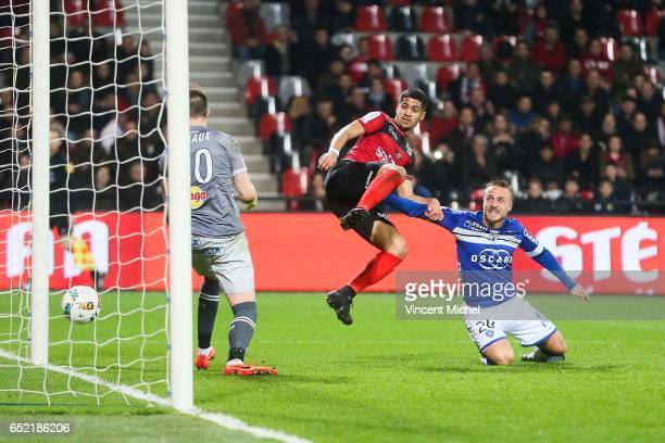 Ludovic Blas of Guingamp scores the fourth goal past Pierre Bengtsson and Alexis Thebaux of Bastia during the Ligue 1 match between EA Guingamp and...