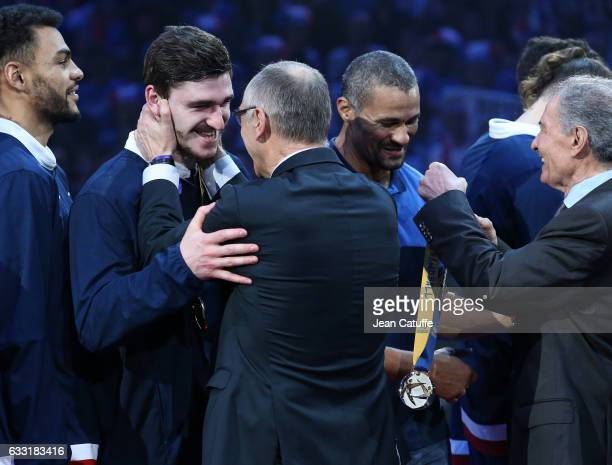 Ludovic Fabregas and coach of France Didier Dinart receive their gold medals from FFH President Joel Delplanque and IHF President Hassan Moustafa...