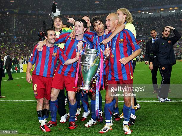 Ludovic Giuly Mark Van Bommel Giovanni Van Bronckhorst and Henrik Larsson of Barcelona celebrate with the trophy after their team wins the UEFA...