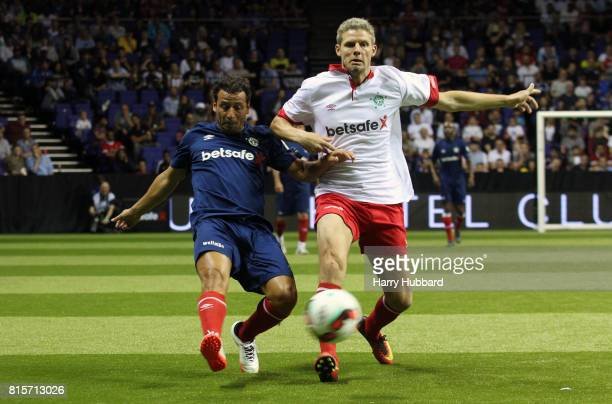 Ludovic Giuly of France and Chris Sorensen of Denmark in action during the Final Star Sixes match between France and Denmark at The O2 Arena on July...