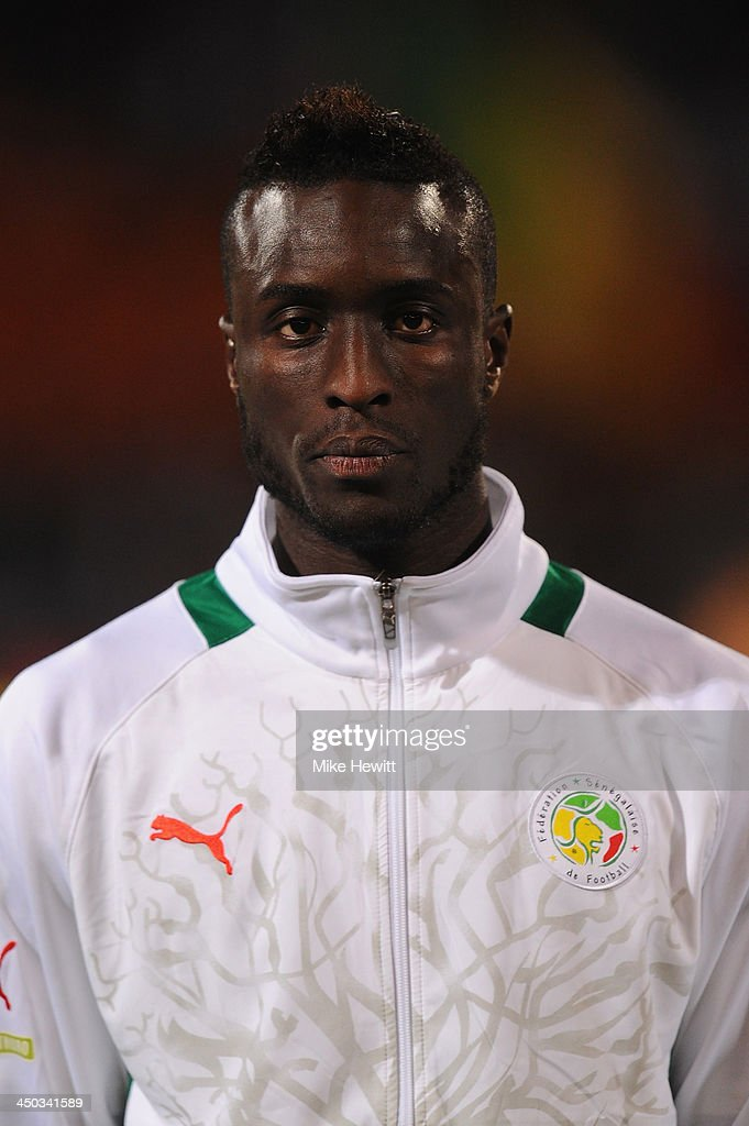 Ludovic Lamine Sane of Senegal lines up for the National Anthem during the FIFA 2014 World Cup Qualifier Play-off Second Leg between Senegal and Ivory Coast at Stade Mohammed V on November 16, 2013 in Casablanca, Morocco.