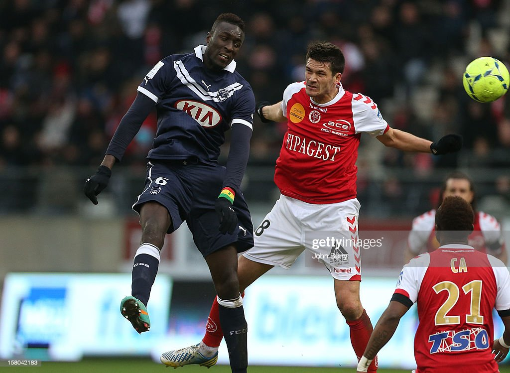 Ludovic Sane of Bordeaux and Johann Ramare of Reims fight for the ball during the French Ligue 1 match between Stade de Reims and Girondins de Bordeaux at the Stade Auguste Delaune on December 9, 2012 in Reims, France.
