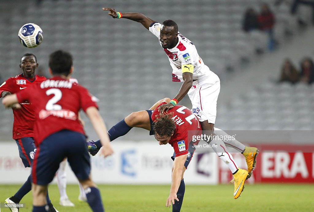 Ludovic Sane of Bordeaux and Michael Frey of Lille in action during the French League Cup (Coupe de la ligue) match between Lille OSC and Girondins de Bordeaux at Grand Stade Pierre Mauroy stadium on December 17, 2014 in Lille, France.