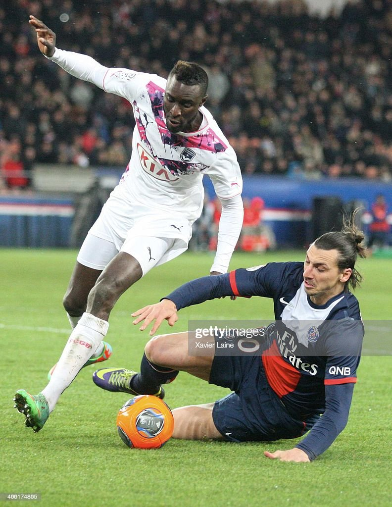 Ludovic Sane of Girondins de Bordeaux and <a gi-track='captionPersonalityLinkClicked' href=/galleries/search?phrase=Zlatan+Ibrahimovic&family=editorial&specificpeople=206139 ng-click='$event.stopPropagation()'>Zlatan Ibrahimovic</a> of Paris Saint-Germain during the French Ligue 1 between Paris Saint-Germain FC and FC Girondins de Bordeaux at Parc Des Princes on january 31, 2014 in Paris, France.