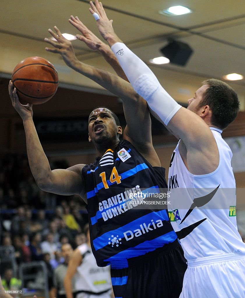 Ludovic Vaty (L) of French BCM Gravelines Dunkerque fights for the ball with Marton Bader (R) of Hungarian KK Szolnoki Olaj on January 15, 2015 during their FIBA EuroChallenge match.