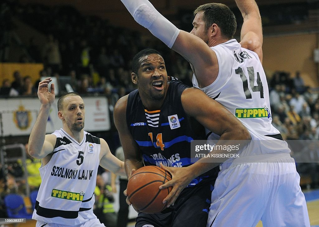 Ludovic Vaty (C) of French BCM Gravelines Dunkerque fights for the ball with Marton Bader (R) and Akos Horvath (L) of Hungarian KK Szolnoki Olaj on January 15, 2015 during their FIBA EuroChallenge match.