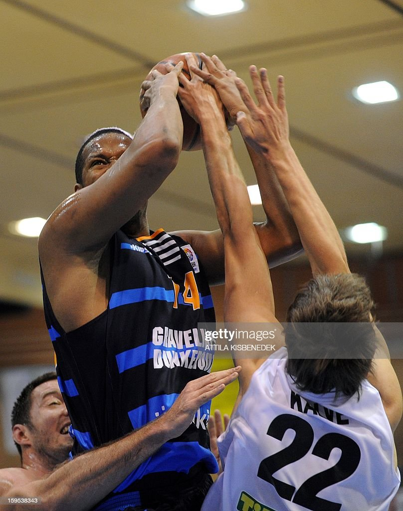 Ludovic Vaty (C) of French BCM Gravelines Dunkerque fights for the ball with Marton Bader (L) and Ernests Kalve (R) of Hungarian KK Szolnoki Olaj on January 15, 2015 during their FIBA EuroChallenge match.