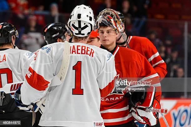 Ludovic Waeber of Team Switzerland congratulates Zachary Fucale of Team Canada for the win during the 2015 IIHF World Junior Hockey Championship...