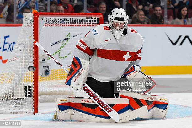 Ludovic Waeber of Team Switzerland makes a save during the 2015 IIHF World Junior Hockey Championship exhibition game against Team Canada at the Bell...