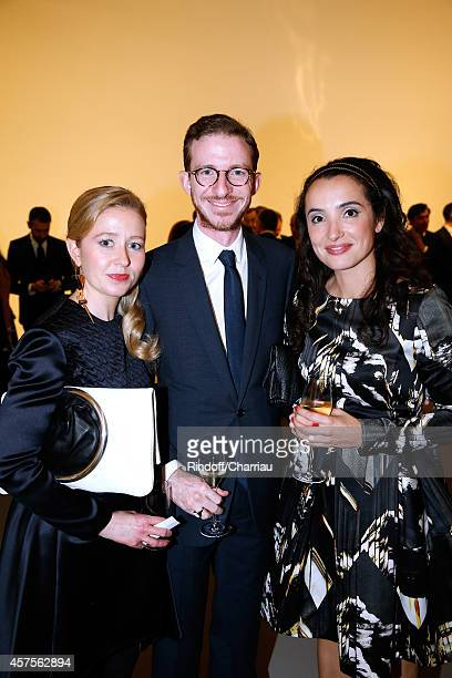 Ludovic Watine Arnauld his sister Stephanie Watine Arnault and Isabelle Vitari attend the Foundation Louis Vuitton Opening at Foundation Louis...