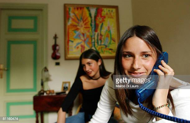 Ludovica Lombardini talks on the phone to a friend as her friend Virginia Recchi waits in Ludovica's bedroom June 7 2004 in Rome Italy In Rome...