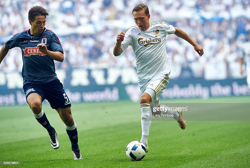 Ludvig Augustinsson of FC Copenhagen and Alexander Juel Andersen of AGF Aarhus compete for the ball during the Danish Alka Superliga match between FC Copenhagen and AGF Aarhus at Telia Parken Stadium on May 29, 2016 in Copenhagen, Denmark.