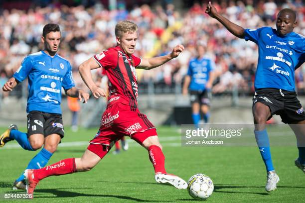 Ludvig Fritzon of Ostersunds FK and Aboubakar Keita of Halmstad BK competes for the ball during the Allsvenskan match between Ostersunds FK and...