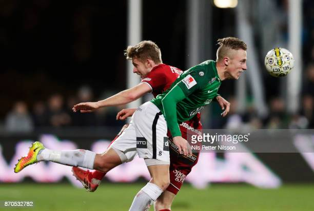 Ludvig Fritzon of Ostersunds FK and Joakim Karlsson of Jonkopings Sodra competes for the ball during the Allsvenskan match between Jonkopings Sodra...