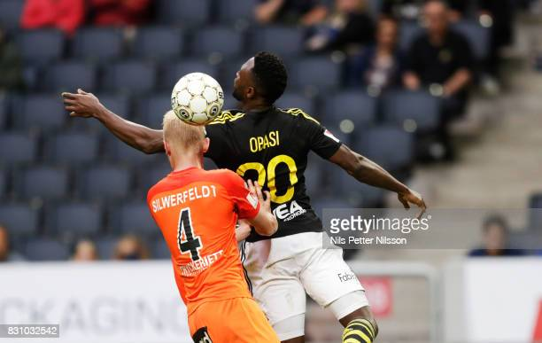 Ludvig Ohman Silwerfeldt of Athletic FC Eskilstuna and Chinedu Obasi of AIK competes for the ball during the Allsvenskan match between AIK and...