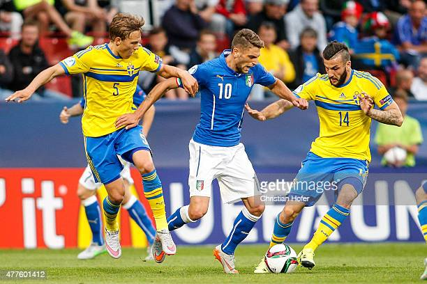 Ludwig Augustinsson and Mikael Ishak of Sweden compete for the ball with Domenico Berardi of Italy during the UEFA Under21 European Championship...