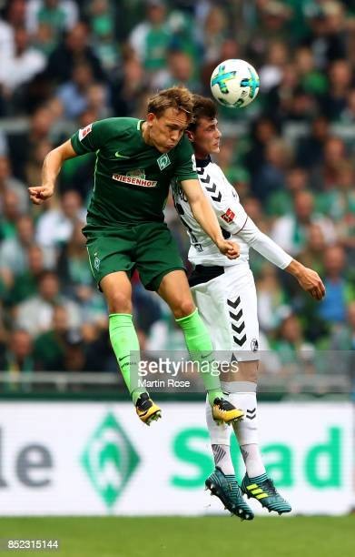 Ludwig Augustinsson of Bremen and Pascal Stenzel of Freiburg battle for the ball during the Bundesliga match between SV Werder Bremen and SportClub...