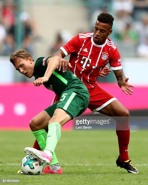 Ludwig Augustinsson of Bremen is challenged by Corentin Tolisso of Muenchen during the Telekom Cup 2017 Final between SV Werder Bremen and FC Bayern...