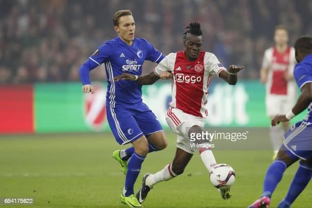 Ludwig Augustinsson of FC Copenhagen Bertrand Traore of Ajaxduring the UEFA Europa League round of 32 match between Ajax Amsterdam and FC Copenhagen...