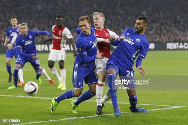 Ludwig Augustinsson of FC Copenhagen Donny van de Beek of Ajax Youssef Toutouh of FC Copenhagenduring the UEFA Europa League round of 32 match...