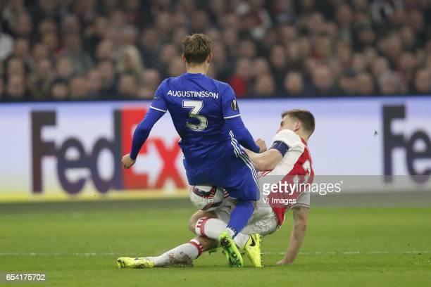 Ludwig Augustinsson of FC Copenhagen Joel Veltman of Ajaxduring the UEFA Europa League round of 32 match between Ajax Amsterdam and FC Copenhagen at...