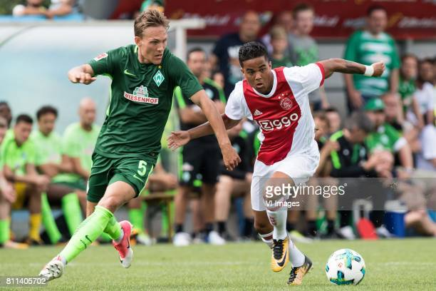Ludwig Augustinsson of SV Werder Bremen Justin Kluivert of Ajax during the friendly match between Ajax Amsterdam and SV Werder Bremen at...