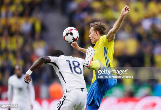 Ludwig Augustinsson of Sweden and Moussa Sissoko of France competes for the ballduring the FIFA 2018 World Cup Qualifier between Sweden and France at...