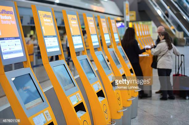 Lufthansa boarding pass automats pictured at the Frankfurt Airport on October 21 2014 in Frankfurt am Main Germany Vereinigung Cockpit the labor...