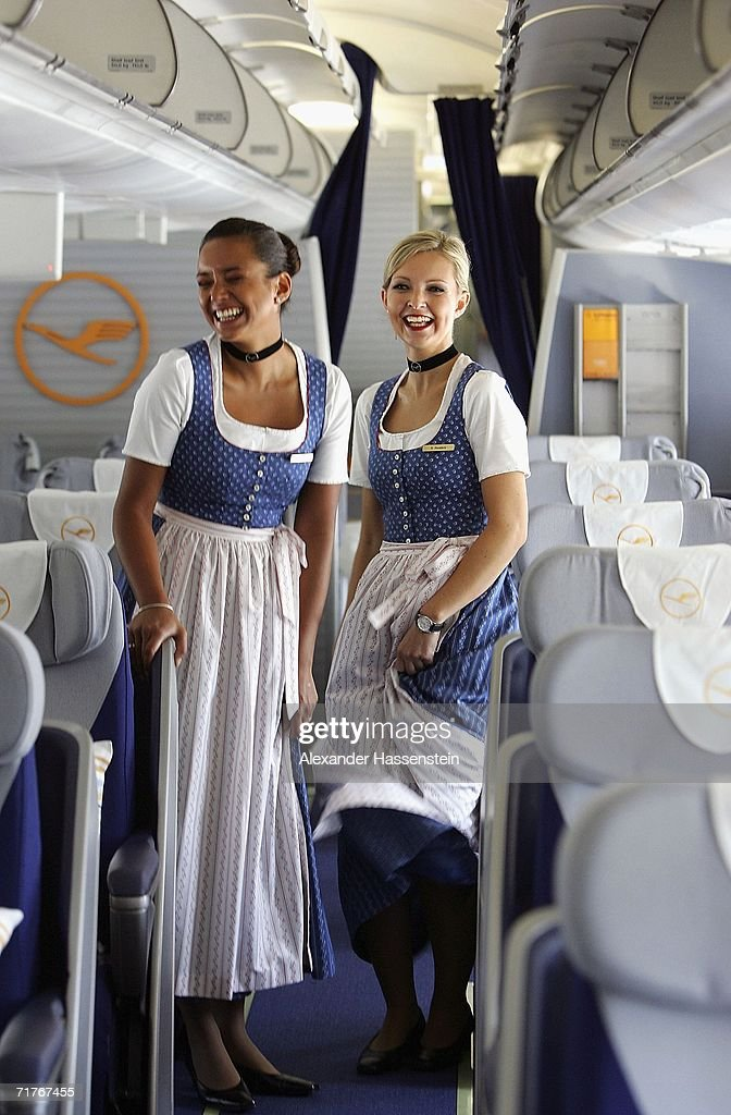 Lufthansa cabin crew member Nina Olah (L) and Sandra Raddatz (R) posing in traditional 'Blaudruck Dirndl' dress on September 01, 2006 in Munich, Germany. From September 1 to October 3 Lufthansa cabin crew will dress in the Bavarian traditional costume.
