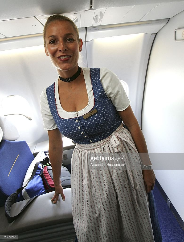 Lufthansa cabin crew memberCaroline Hofbaur poses in traditional 'Blaudruck Dirndl' dress on September 01, 2006 in Munich, Germany. From September 1 to October 3 Lufthansa cabin crew will dress in the Bavarian traditional costume.