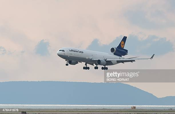 A lufthansa cargo plane arrives on June 9 2015 in Marseille southern France to rapatriate the remains of the Germanwings flight crash victims in...