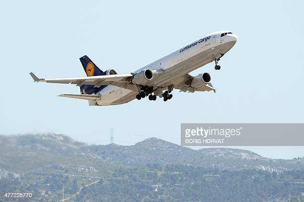 A Lufthansa cargo plane takes off from the MarseilleProvence airport in Marignane southern France on June 15 2015 to rapatriate to Spain 32 coffins...
