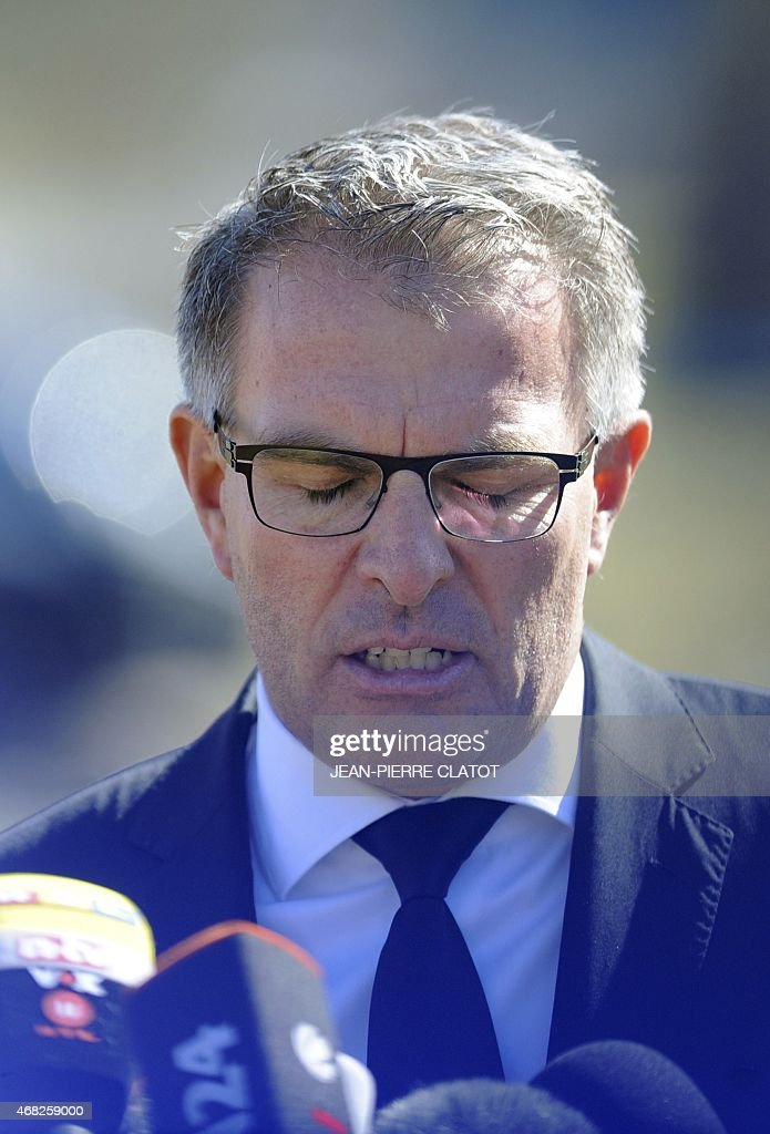 Lufthansa CEO Carsten Spohr speaks to the press after laying a wreath with the CEO of Germanwings near a stele in memory of the victims of the...