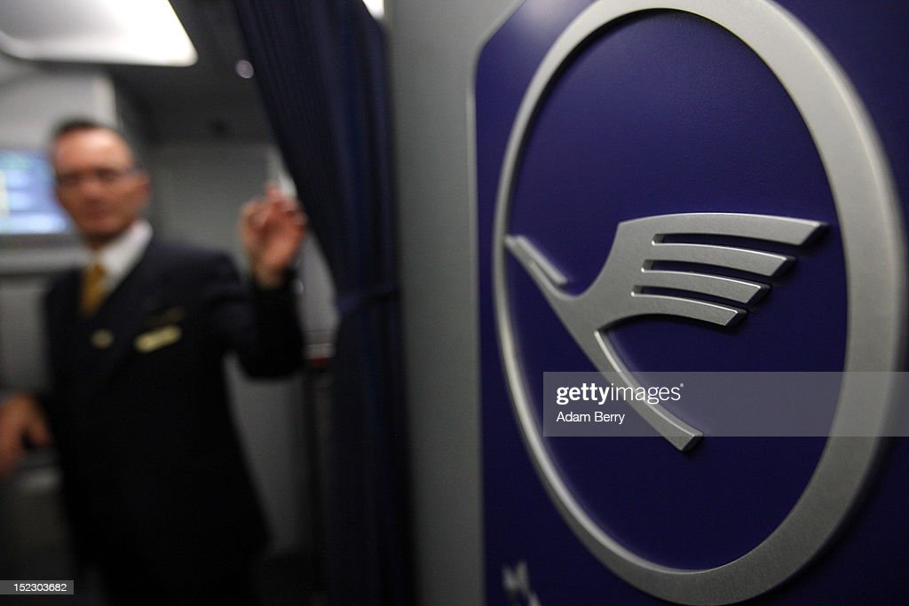 A Lufthansa flight attendant closes a curtain on a flight to Berlin next to a Lufthansa logo on September 15, 2012 at Munich Airport in Munich, Germany. After the latest in a series of Lufthansa cabin crew strikes led by the flight attendants' union UFO, actions demanding guarantees for job security as well as a five percent salary increase, resulting in nearly 1,800 flight cancellations after 13 months of contract negotiations, the strikers and the airline have agreed upon a former economic adviser to the German government, Bert Ruerup, as an arbitrator, who has stated that he expects a solution by the end of October. The cabin crew union has agreed not to strike over the estimated six weeks of discussions.