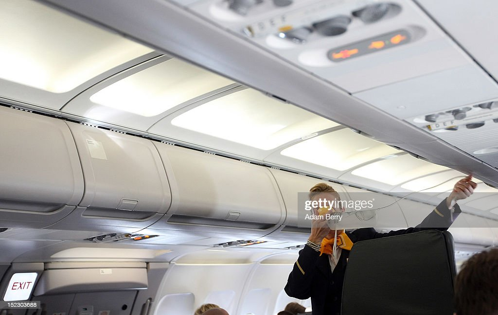 A Lufthansa flight attendant instructs passengers on the use of their oxygens masks on a flight to Frankfurt on September 14, 2012 at Tegel airport in Berlin, Germany. After the latest in a series of Lufthansa cabin crew strikes led by the flight attendants' union UFO, actions demanding guarantees for job security as well as a five percent salary increase, resulting in nearly 1,800 flight cancellations after 13 months of contract negotiations, the strikers and the airline have agreed upon a former economic adviser to the German government, Bert Ruerup, as an arbitrator, who has stated that he expects a solution by the end of October. The cabin crew union has agreed not to strike over the estimated six weeks of discussions.