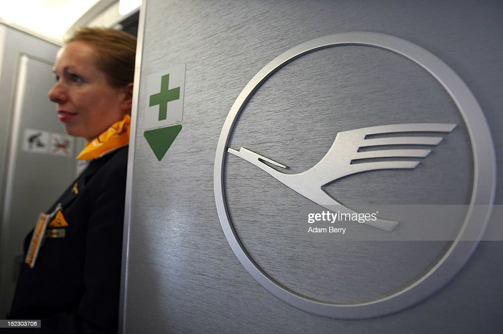 A Lufthansa flight attendant waits for a flight to Frankfurt to take off on September 14, 2012 at Tegel airport in Berlin, Germany. After the latest in a series of Lufthansa cabin crew strikes led by the flight attendants' union UFO, actions demanding guarantees for job security as well as a five percent salary increase, resulting in nearly 1,800 flight cancellations after 13 months of contract negotiations, the strikers and the airline have agreed upon a former economic adviser to the German government, Bert Ruerup, as an arbitrator, who has stated that he expects a solution by the end of October. The cabin crew union has agreed not to strike over the estimated six weeks of discussions.
