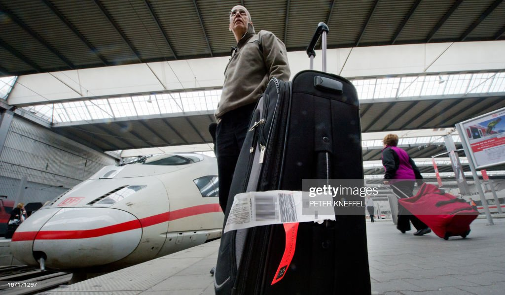 A Lufthansa flight passenger from South Africa waits at the main railway station in Munich, southern Germany, on April 22, 2013, during a warning strike of ground staff of German airline Lufthansa. German airline Lufthansa said it has cancelled most of its domestic, European and long-haul flights at six German airports due to strike action by ground personnel and some cabin crew. AFP PHOTO / PETER KNEFFEL / GERMANY