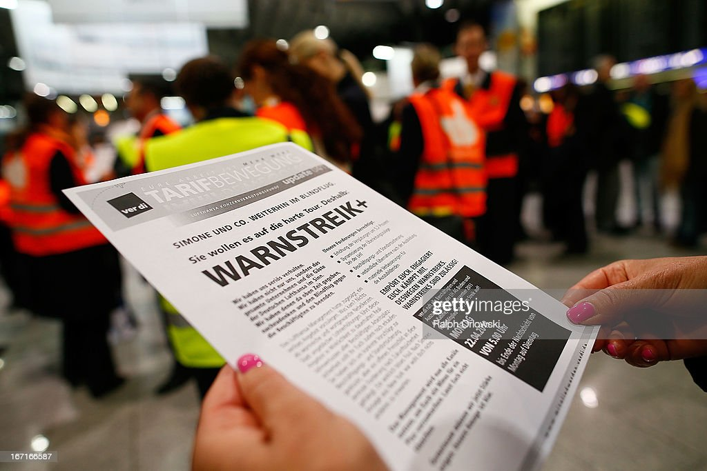 Lufthansa personnel read a pamphlet during a nationwide protest at Frankfurt Airport on April 22, 2013 in Frankfurt, Germany. Workers are demanding pay raises and job guarantees and today's strike has forced Lufthansa to cancel approximately 1700 flights.