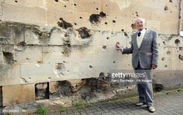 Luftwaffe pilot Willi Schludecker alongside the bomb damaged former Labour Exchange in Bath